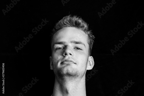 Portrait of a self-confident young unshaven guy, black and white photo Slika na platnu