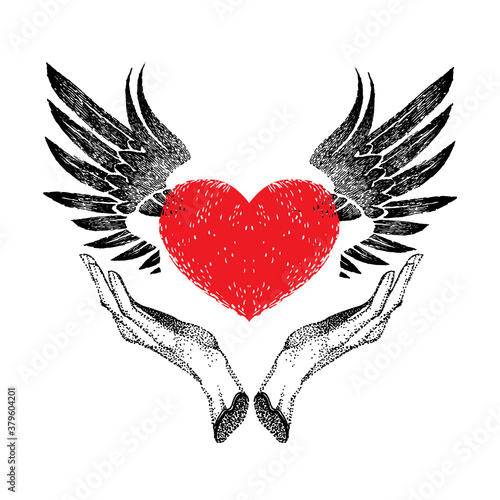 Fotografija vintage graphic red heart with open black wings in hands