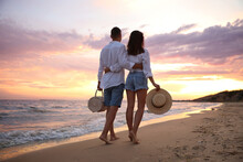 Lovely Couple Walking On Beach...
