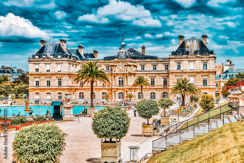 Obraz PARIS, FRANCE - JULY 08, 2016 : Luxembourg Palace and park in Paris, the Jardin du Luxembourg, one of the most beautiful gardens in Paris. France. - fototapety do salonu