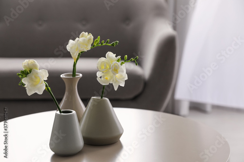Fototapeta Beautiful spring freesia flowers on white table in room obraz
