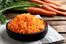 Grated Carrot In Plate On Wood...