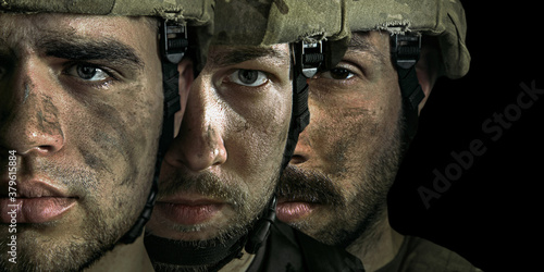 Close up portrait of young male soldiers. Men in military uniform on the war on black background. Depressed and having problems with mental health and emotions, PTSD, rehabilitation. Collage.