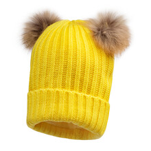 Yellow Women Wool Knit Hat With Faux Fur Pompom Isolated On White. Knit Cap Folded Brim. Tuque Or Toque Outdoors Headgear. Ski Bobble Hat Topped With Pom Pom Or Loose Tassels. Lady Knitted Warm Hat
