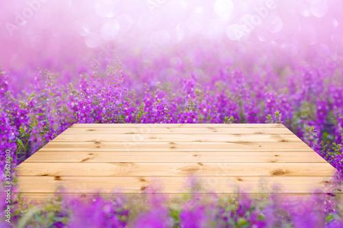 Fototapeta Empty wooden table top with purple or violet flower fields obraz