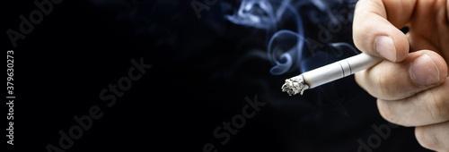 Fotografie, Obraz Cigarette hand black background