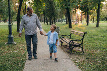 Boy With His Grandfather Walki...