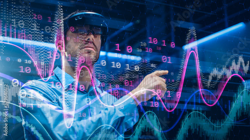 Caucasian Male IT Specialist and Businessman Wearing Futuristic VR Helmet and Working with Digital Data Canvas Print