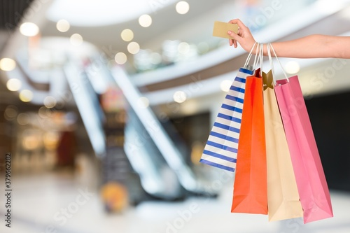 Woman hand with many shopping bags and credit card Canvas