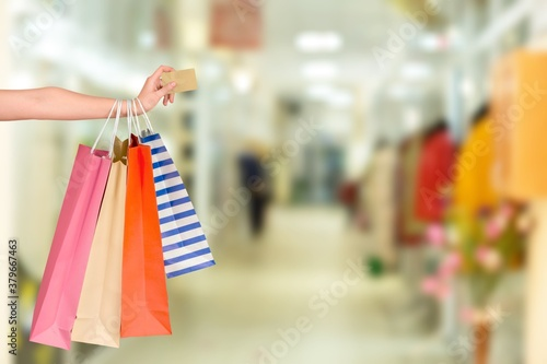 Foto Woman hand with many shopping bags and credit card