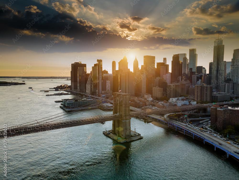Fototapeta Brooklyn bridge at dusk at lower Manhattan skyline on the East River at New York, New York, USA