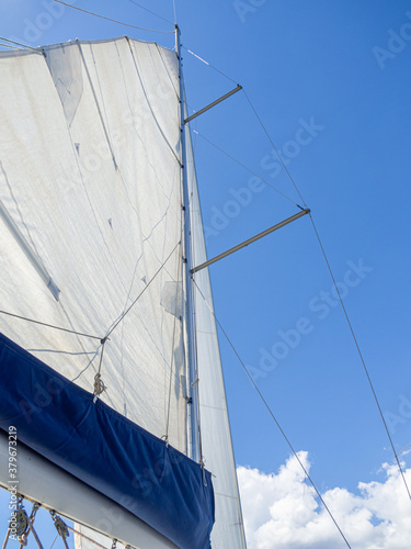 Sailboat mast in the mediterranean sea with blue sky Wallpaper Mural