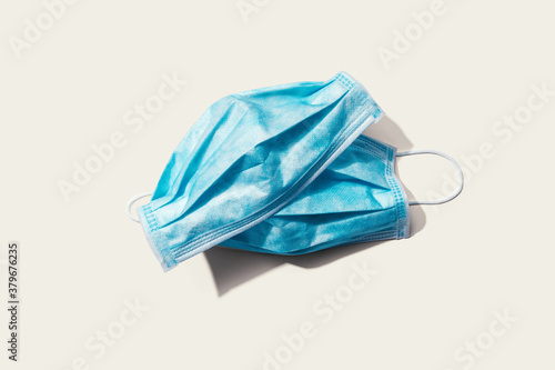 Fototapeta Blue surgical masks overhead view - flat lay obraz