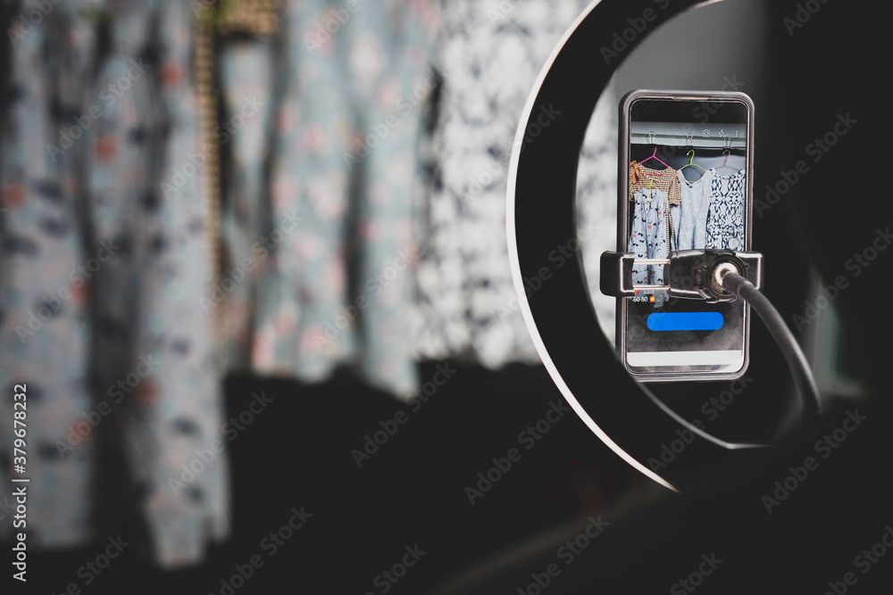 Fototapeta vision of camera phone focus on women dress for sell, streaming and live on online market.