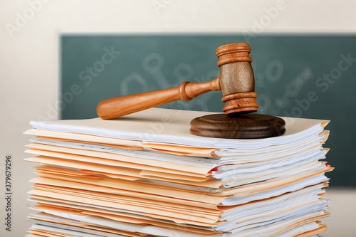 Judge wooden hammer and stack documents Poster Mural XXL