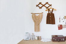 Cute Nursery Decorating Ideas, Baby Room Designs Decor. Toddler Baby Organic Cotton Clothes Hanging On The Rack And Rustic Retro Accessories On White Wall.