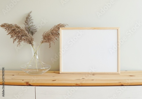 Fototapeta Horizontal wooden frame mockup for photo, print, painting, artwork presentation, boho style decorations, wooden shelf.  obraz