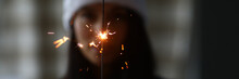 Woman Hold Sparklers In Hand C...