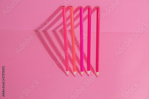 pink background with pink wooden pencils