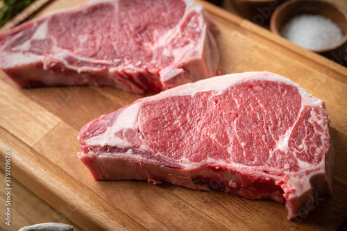 raw steak meat on cutting board in bright kitchen Tableau sur Toile