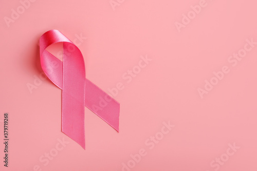 Pink ribbon on pink background Canvas Print