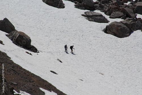 Fotografie, Obraz hikers crossing a snowfield