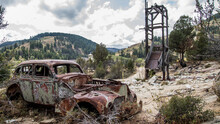 Old Rusty Vehicle In Silver City Idaho With Suicide Doors And Handles.