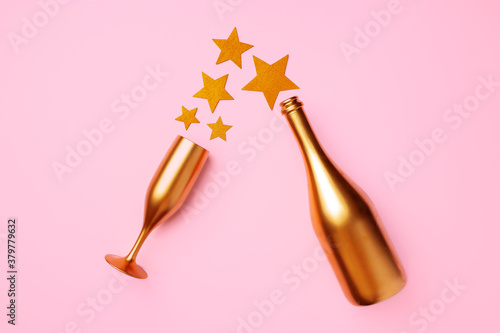 Obraz Champagne bottle with confetti flat lay top view - fototapety do salonu