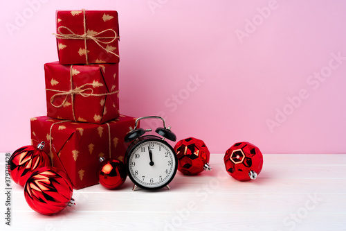 Fototapeta Christmas and New Year countdown concept with alarm clock obraz