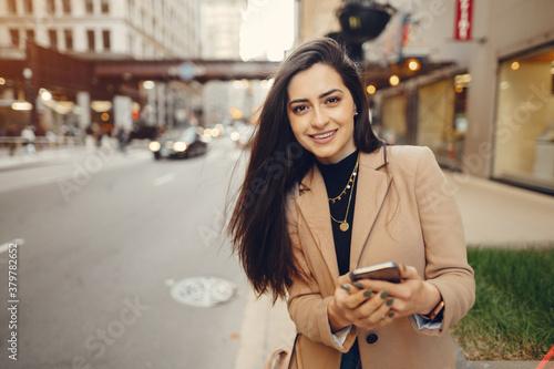 Beautiful girl in a city Fototapet