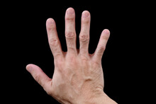 Right Hand, Adult Male, Facing Downwards, Showing Back Of Hand, Isolated On Black Background. Asian Man's Hand, Fingers Spread, Palm Down, Dorsal View, Lying On Black Surface. Closeup, Top View.
