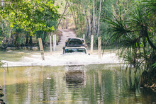 Half Submerged Suv As It Crosses A River