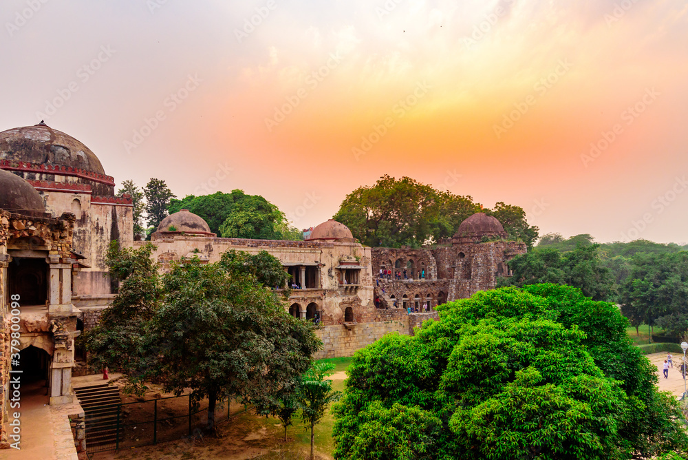 Fototapeta Sunset view of the landmark Hauz Khas Complex, a medieval village complex with lake that is now a tourist attraction in Delhi.