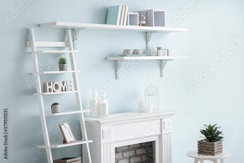 Fototapeta Modern fireplace with shelves in interior of room obraz