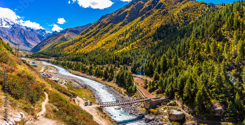 Obraz Serene Landscape of Baspa river valley near Chitkul village in Kinnaur district of Himachal Pradesh, India. It is the last inhabited village near the Indo-China border. - fototapety do salonu