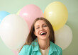 canvas print picture Young woman with balloons on color background