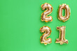 canvas print picture - Balloons in shape of figure 2021 on color background. New Year celebration