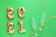 canvas print picture - Balloons in shape of figure 2021 and glasses on color background. New Year celebration