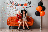 Beautiful young women at Halloween party