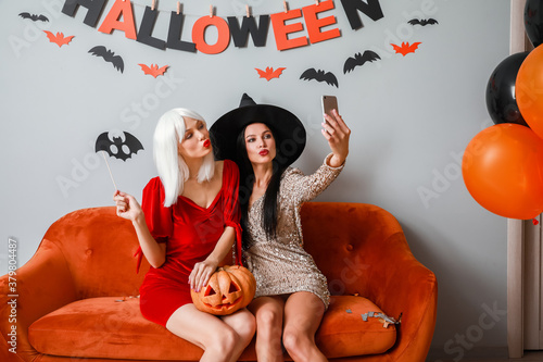 Beautiful young women taking selfie at Halloween party Canvas-taulu