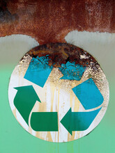 Close Up Of Recycling Symbol On Industrial Trash Can