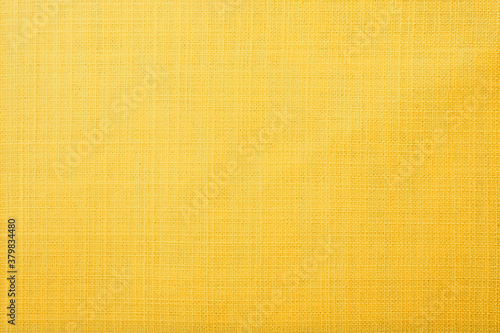 Fotografiet Yellow linen fabric of table cloth texture background