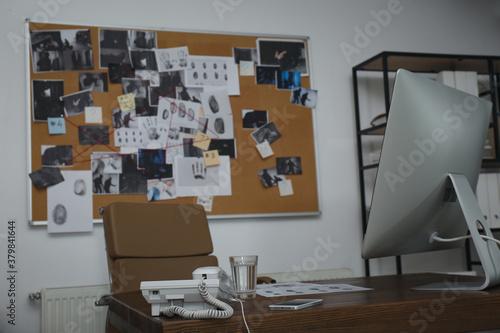 Obraz na plátně Modern detective office with computer and board