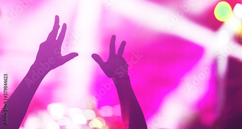 Silhouette photo of hands worship god together in church hall in front of music stage