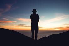 Man's Silhouette Against Ocean Sunset