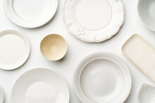 Top View Of Empty Plates On Wh...