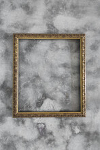 Empty Gold Frame On Concrete Background With Copyspace
