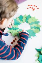 Little Boy Making Christmas Decoration Craft