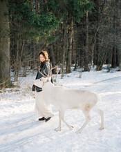 Woman Walking With Deer