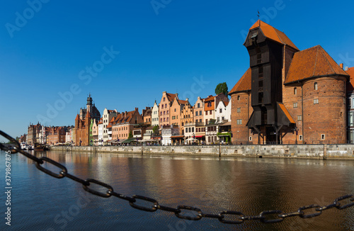 Motlawa river embankment in historical part of Gdansk at sunny day, Poland Wallpaper Mural